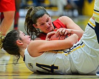 KENT, OHIO - NOVEMBER 20, 2018: Kent State's Lindsey Thall and Youngstown State's Madison Mallory wrestle for the loose ball during the second half of their game, Tuesday night at the Memorial Athletic and Convocation Center. Kent State won 62-34. (David Dermer/Special to the Record Courier)