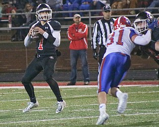 Girard's Mark Waid drops back to pass in Dover on Saturday November 24, 2018. ETHAN CLEWELL | THE VINDICATOR