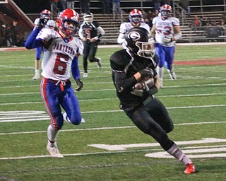 Aidan Wargan sprints to the end zone after catch in Dover on Saturday November 24, 2018. ETHAN CLEWELL | THE VINDICATOR
