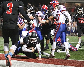 Mark Waid falls into the end zone for a touchdown to take the lead in Dover, Ohio on Saturday Nov. 24, 2018.. ETHAN CLEWELL | THE VINDICATOR