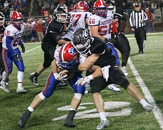 Girard's Nick Malito tackles Licking Valleys Connor McLaughlin in Dover, Ohio on Saturday Nov. 24, 2018. ETHAN CLEWELL | THE VINDICATOR