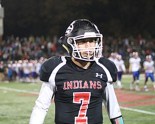 Girard's Mark Waid walks off the field after kneeling the ball to kill the clock and win the game 53-48. Waid threw for totaled for 576 yards and 6 touchdowns.. ETHAN CLEWELL | THE VINDICATOR