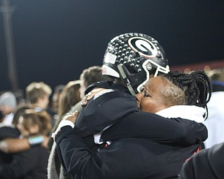 Girards Jimmy Jones embraces a Girard fan after state semi final win in Dover, Ohio on Saturday Nov. 24, 2018. ETHAN CLEWELL | THE VINDICATOR