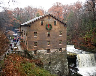 Lanterman's Mill is decked out in wreaths for its Olde Fashioned Christmas event on Saturday. EMILY MATTHEWS | THE VINDICATOR