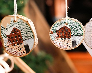 Painted wooden ornaments and dream catchers made by Kathy Bowman, of Austintown, are displayed and sold at Lanterman's Mill Olde Fashioned Christmas on Saturday. EMILY MATTHEWS | THE VINDICATOR