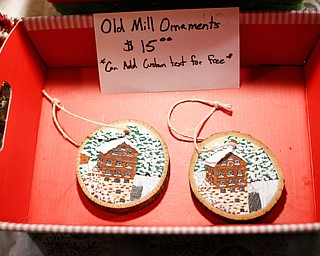 Painted wooden ornaments made by Kathy Bowman, of Austintown, are displayed and sold at Lanterman's Mill Olde Fashioned Christmas on Saturday. EMILY MATTHEWS | THE VINDICATOR