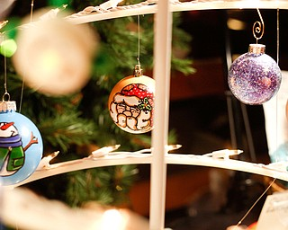 Painted ornaments by Lindy Young, of Austintown, are displayed and sold at Lanterman's Mill Olde Fashioned Christmas on Saturday. EMILY MATTHEWS | THE VINDICATOR