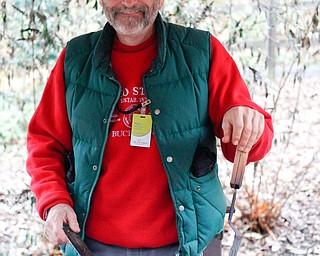 Ray Novotny, of Cornersburg, roasts chestnuts at Lanterman's Mill Olde Fashioned Christmas on Saturday. EMILY MATTHEWS | THE VINDICATOR