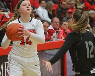 William D. Lewis The Vindicator YSU's McKenah Peters(34) passes around Akron's Shayna Harmon(12).