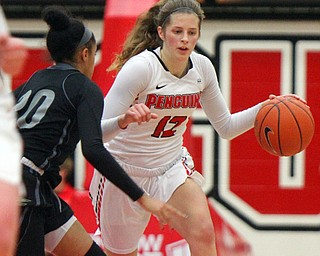 William D. Lewis The Vindicator YSU's Chelsea Olson(12) drives around Akron's Gabrielle Brown-Mitchell(20).