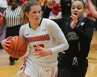 William D. Lewis The Vindicator YSU's Chelsea Olson(12) drives around Akron's Kendall Miller(1).