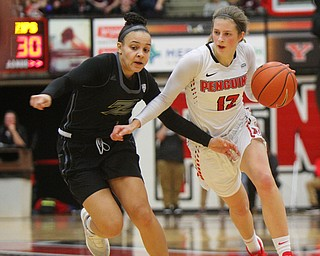 William D. Lewis The Vindicator YSU's Chelsea Olson(12) drives around Akron's Kendal Miller(1).