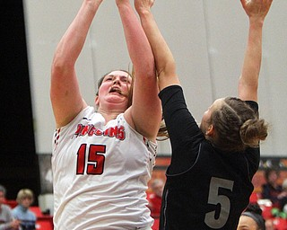 William D. Lewis The Vindicator YSU'sMary Dunn(15) ) shoots around Akron's Haliegh Reinoehl(5).