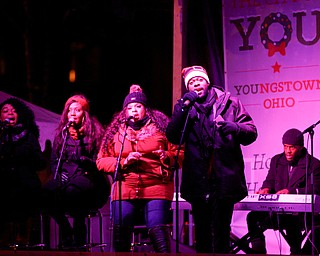 Josh Triplett performs before Youngstown's annual Holiday Parade on Friday night. EMILY MATTHEWS | THE VINDICATOR