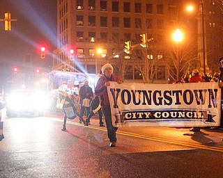 The Youngstown City Council marches in Youngstown's annual Holiday Parade on Friday night. EMILY MATTHEWS | THE VINDICATOR