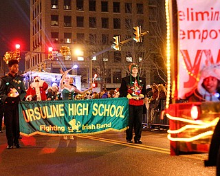 The Ursuline High School Fighting Irish Band marches behind the YWCA in Youngstown's annual Holiday Parade on Friday night. EMILY MATTHEWS | THE VINDICATOR