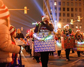 Members of the Crestview Rebels Marching Band perform while being dressed as Christmas presents during Youngstown's annual Holiday Parade on Friday night. EMILY MATTHEWS | THE VINDICATOR