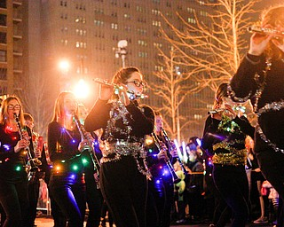 Members of the Lakeview High School Marching Band perform while wrapped in garland and Christmas lights during Youngstown's annual Holiday Parade on Friday night. EMILY MATTHEWS | THE VINDICATOR