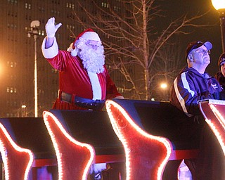 Santa waves to the crowd during Youngstown's annual Holiday Parade on Friday night. EMILY MATTHEWS | EMILY MATTHEWS