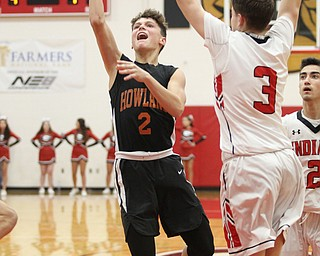 Howland's Gage Tomko (2) goes up for a shot while being defended by Girard's Matt Payich (3) during Friday nights matchup at Girard High School.  Dustin Livesay  |  The Vindicator  11/30/18  Girard