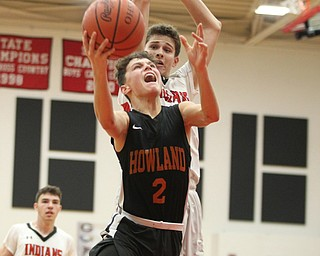 Howland's Gage Tomko (2) goes in for a layup during Friday nights matchup at Girard High School.  Dustin Livesay  |  The Vindicator  11/30/18  Girard