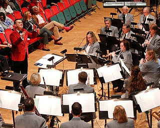 The Packard Band, led by Dr. Stephen L. Gage, perform Country Cookin' Christmas during their annual Christmas Spectacular at W.D. Packard Music Hall on Sunday afternoon. EMILY MATTHEWS | THE VINDICATOR