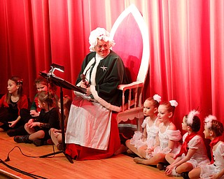 Mrs. Claus reads The Night Before Christmas during The Packard Band annual Christmas Spectacular at W.D. Packard Music Hall on Sunday afternoon. EMILY MATTHEWS | THE VINDICATOR