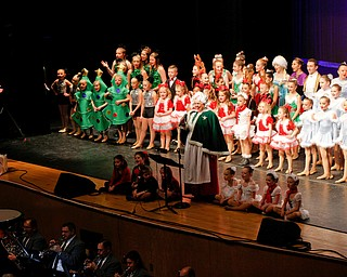 Mrs. Claus and dancers sing We Wish You a Merry Christmas during The Packard Band annual Christmas Spectacular at W.D. Packard Music Hall on Sunday afternoon. EMILY MATTHEWS | THE VINDICATOR