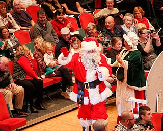 Santa greets the crowd with Mrs. Claus during The Packard Band annual Christmas Spectacular at W.D. Packard Music Hall on Sunday afternoon. EMILY MATTHEWS | THE VINDICATOR
