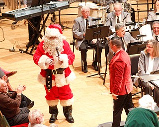 Santa greets the crowd during The Packard Band annual Christmas Spectacular at W.D. Packard Music Hall on Sunday afternoon. EMILY MATTHEWS | THE VINDICATOR