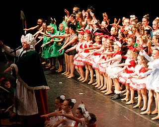 Dancers join Mrs. Claus to sing and dance to the song Baby Shark during The Packard Band annual Christmas Spectacular at W.D. Packard Music Hall on Sunday afternoon. EMILY MATTHEWS | THE VINDICATOR