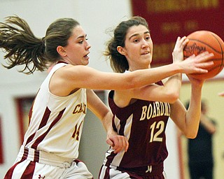William D. Lewis The Vindicator Mooney's Camden Hergenrother(14) defends against Boardman's Bailey Moore(12) during 12-3-18 action at Mooney.