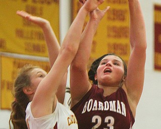 William D. Lewis The Vindicator Board,man's Maria Torres(23) shoots past Mooney's Alaina Scavina(24) during 12-3-18 action at Mooney.