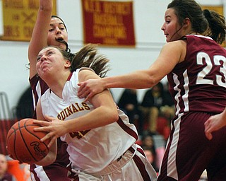 William D. Lewis The Vindicator Mooney's Conchetta Renaldi(42) drives past Boardman's Katie Stamp(41) and Maria Torres(23) during 12-3-18 action at Mooney.