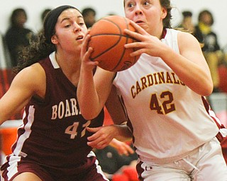 William D. Lewis The Vindicator Mooney's Conchetta Renaldi(42) drives past Boardman's Katie Stamp(41)  during 12-3-18 action at Mooney.
