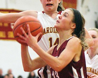William D. Lewis The VindicatorBoardman's Cate Green(13) shoots past Mooney'sCamden Hergenbother(14) during 12-3-18 action at Mooney.