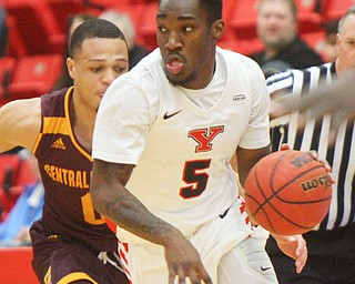 William D. Lewis the Vindicator  YSU's Kendale HAmpton(5) drives around CMU's Larry Austin Jr.(0) during 12-4-18 action at YSU.