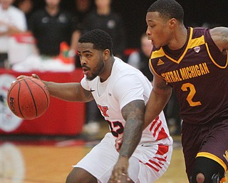 William D. Lewis the Vindicator  YSU'sDevin Morgan(22) drives around CMU's Shawn Roundtree(2) during 12-4-18 action at YSU.