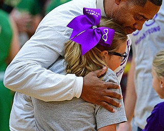 CANFIELD, OHIO - DECEMBER 4, 2018: Hannah Tringhese gets a hug from Ursuline head coach Keith Gunther during the first half of their game, Tuesday night at South Range High School. DAVID DERMER | THE VINDICATOR