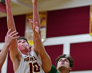 CANFIELD, OHIO - DECEMBER 4, 2018: South Range's Chris Brooks grabs a rebound away from Ursuline's Luke Pipala during the first half of their game, Tuesday night at South Range High School. DAVID DERMER | THE VINDICATOR