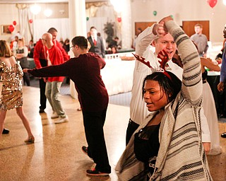 Harmonie Walker, 15, a student at Warren G. Harding High School, dances with Philip Davis, of Youngstown, at the 18th annual Winterfest dance at The Mahoning Country Club on Wednesday night. EMILY MATTHEWS | THE VINDICATOR