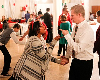 Harmonie Walker, 15, a student at Warren G. Harding High School, and Philip Davis, of Youngstown, dance to All I Want for Christmas is You at the 18th annual Winterfest dance at The Mahoning Country Club on Wednesday night. EMILY MATTHEWS | THE VINDICATOR