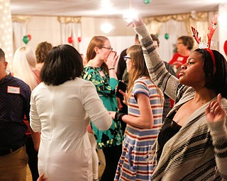 Harmonie Walker, right, 15, a student at Warren G. Harding High School, dances with other students at the 18th annual Winterfest dance at The Mahoning Country Club on Wednesday night. EMILY MATTHEWS | THE VINDICATOR