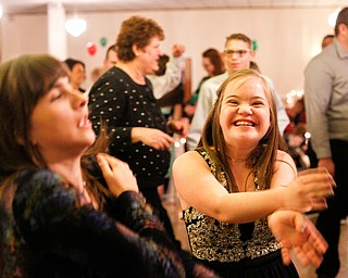 Christin Murcko, right, 16, a student at Poland High School, and Katelyn Hall, 16, a student at Fitch High School, dance the Macarena at the 18th annual Winterfest dance at The Mahoning Country Club on Wednesday night. EMILY MATTHEWS | THE VINDICATOR