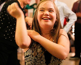 Christin Murcko, 16, a student at Poland High School, dances to the Macarena with other students at the 18th annual Winterfest dance at The Mahoning Country Club on Wednesday night. EMILY MATTHEWS | THE VINDICATOR