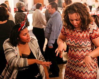 Harmonie Walker, left, 15, a student at Warren G. Harding High School, and Starr Spencer, 16, a student at Potential Development, dance at the 18th annual Winterfest dance at The Mahoning Country Club on Wednesday night. EMILY MATTHEWS | THE VINDICATOR