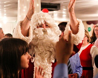 Santa dances with students at the 18th annual Winterfest dance at The Mahoning Country Club on Wednesday night. EMILY MATTHEWS | THE VINDICATOR