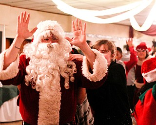Santa leads a dance train at the 18th annual Winterfest dance at The Mahoning Country Club on Wednesday night. EMILY MATTHEWS | THE VINDICATOR