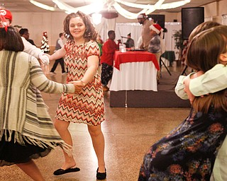 Starr Spencer, center, 16, a student at Potential Development, dances with other students while Katelyn Hall, 16, and Chad Berry, 15, both students at Fitch, hug on the dance floor at the 18th annual Winterfest dance at The Mahoning Country Club on Wednesday night. EMILY MATTHEWS | THE VINDICATOR