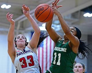 AUSTINTOWN, OHIO - DECEMBER 5, 2018: Fitch's Sabrina Hunter and Ursuline's DayShanette Harris battle for a loose ball during the first half of their game, Wednesday night at Austintown Fitch High School. DAVID DERMER | THE VINDICATOR